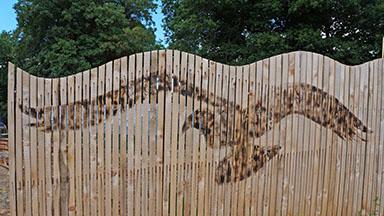 Bird motif on fence at LandWorks